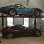 Car lift, two corvettes